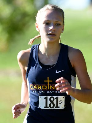 Seton Catholic's Jenna Barker leads the cross country sectional race Saturday, Oct. 8, 2016 at Connersville High School.