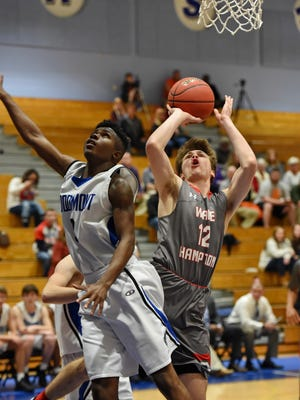 Wade Hampton's Luke Brenegan drives for a score while defended by Woodmont's Reggie Young.