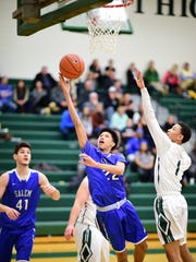 Taking the ball to the basket for Salem is Camren Barden (22), with teammate Kyle Winfrey (41) at left. At right for Novi is Trendon Hankerson (1).