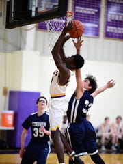 Max Okolo of Plymouth Christian Academy goes in for