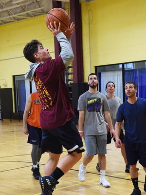Paul DeRico, 23, goes for a shot during a pickup game at Gold's Gym in LaGrange.