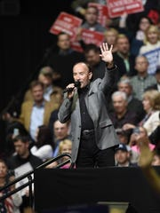 Country music artist Lee Greenwood introduces President Donald Trump during a rally March 15, 2017, at Municipal Auditorium in Nashville, Tenn.