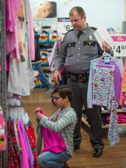 Ava Culver, 10, shops with Chris Baker during the Fraternal
