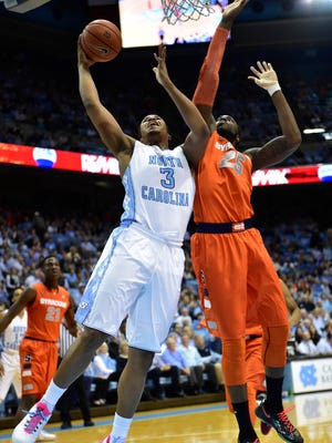 North Carolina forward Kennedy Meeks shoots over Syracuse forward Rakeem Christmas during the first half Monday night.
