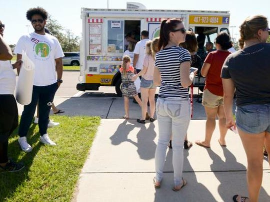 People wait in line to get ice cream from five-year-old Wyatt Sunday at Max K. Rodes Park in West Melbourne. Make A Wish of Central and Northern Florida along with Watertree Health granted Wyatt's wish to be an ice cream man.