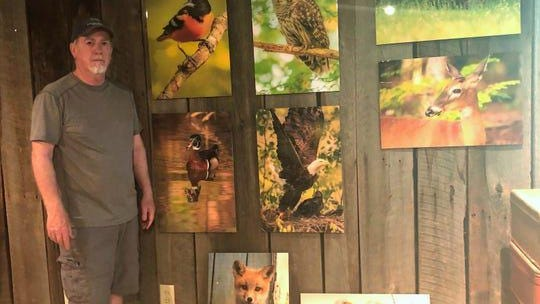 Tim Adams of Coshocton with various wildlife photos he's taken all over Ohio. He's known for his shots of eagles, including a nest in Tuscarawas County.