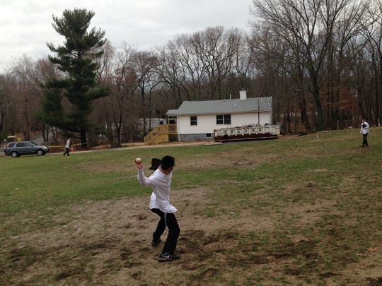 Three young yeshiva students play catch outside their dormitory on Drake Road in Lakewood, just over the border with Jackson on March 15, 2016.