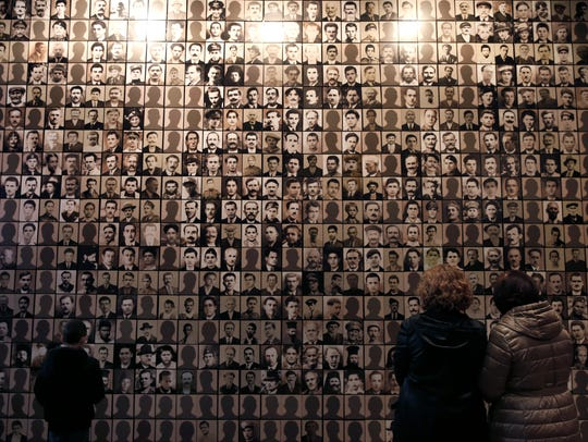 A memorial wall at a Holocaust museum in Kalavryta,