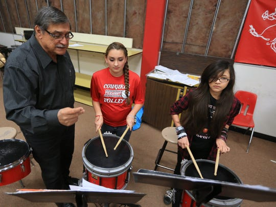 Ernesto Cortez (from left) works with seventh-grade band students Haley Suarez, 13, and Mia Moreno, 13, during band class in April 2016 at Premont Secondary School in Premont. Cortez has taught a total of 22 years at the school district. The Premont High School Mighty Cowboy Band and Mariachi Estrella were selected as the 2017 Section 6 recipient of the National High School Heart of the Arts Award by the National Federation of State High School Associations.