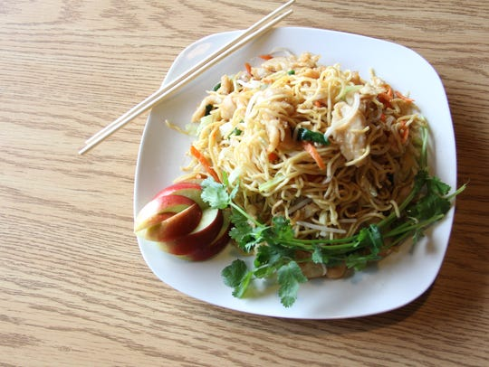 Chicken Lo Nein at Happy Jing Chinese is stir-fried with julienned carrots, bean sprouts, green onions and onion.