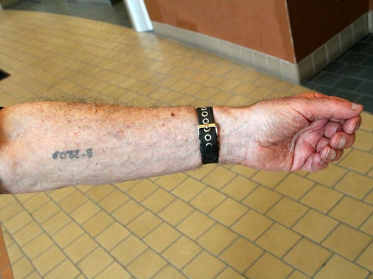Holocaust survivor Harold Gordon, 88, of Salinas displays the number tattooed on him at a concentration camp.