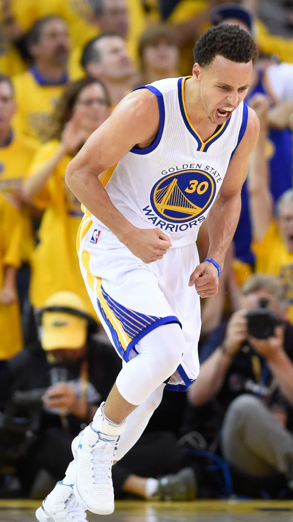 Golden State Warriors guard Stephen Curry (30) reacts after a play during the second quarter against the Cleveland Cavaliers.