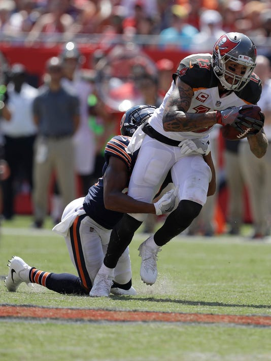 Chicago Bears cornerback Kyle Fuller (23) tackles Tampa Bay Buccaneers wide receiver Mike Evans (13), during the second half of an NFL football game, Sunday, Sept. 17, 2017, in Tampa, Fla. (AP Photo/Chris O'Meara)