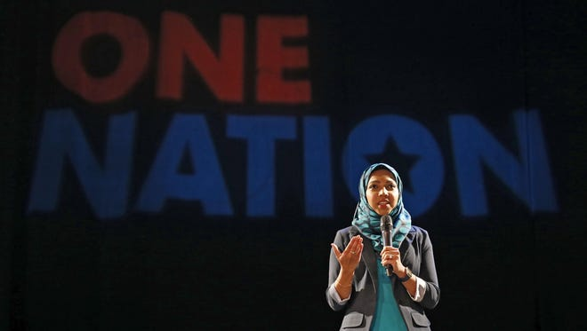 """Nazia Ali speaks during The Enquirer's One Nation event at Bogart's in the Corryville neighborhood of Cincinnati on Wednesday, Sept. 21, 2016. Ali and her husband were removed from a flight for """"being Muslim and making people uncomfortable,"""" she said. Ali continues to wear the hijab despite discrimination."""
