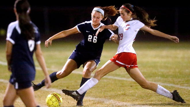 Siegel's Janie Hopper (26) and OaklandÕs Lainey Callis (29) both go after the ball during a soccer game, on Thursday, Sept. 14, 2017, at Oakland.