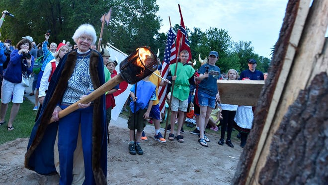 """The new 2017 Fyr Bal chieftain, Anne Petersen Glabe, 91, lights a 25-foot bonfire symbolizing the Scandinavian tradition of burning the """"winter witch'' and welcoming the arrival of summer during the 53rd annual Fyr Bal celebration Saturday, June 17, 2017. At the same time, bonfires are lit along the shoreline around the Ephraim harbor. Glabe is a longtime supportor, activist and volunteer for the village of Ephraim as well as a competitor sailor. """"I am so honored. I love Ephraim more than anywhere on earth,'' she said. To see more photos of Fyr Bal, go the gallery under the Your Key to the Door tab at www.doorcountyadvocate.com."""