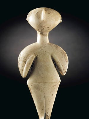 In this photo provided by Christie's is the 9-inch-tall marble sculpture, called the Guennol Stargazer. The statue of a female idol from ancient Turkey dates to around 3000 to 2200 B.C. and is to be auctioned April 28 in New York.