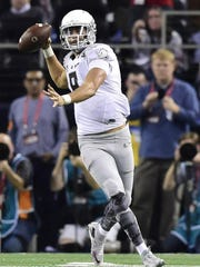 Oregon's Marcus Mariota and the Ducks fall to Ohio State in the College Football Playoff Championship at AT&T Stadium Monday, Jan. 12, 2015, in Arlington, Texas.