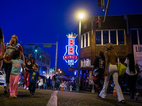 Beale Street, here April 16, 2016, is a prime destination for visitors looking to eat food and listen to blues music, including the B.B. King's Blues Club, in Memphis.