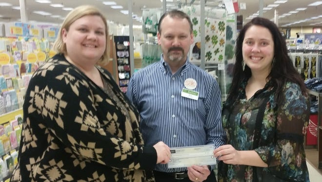 Pictured are Michelle Morris, SOAR parent educator; Eric Rathsack, Shopko store manager; and Natasha Frye, FRC executive director. The Family Resource Center was given a $500 donation by the Shopko Foundation to support the SOAR program.