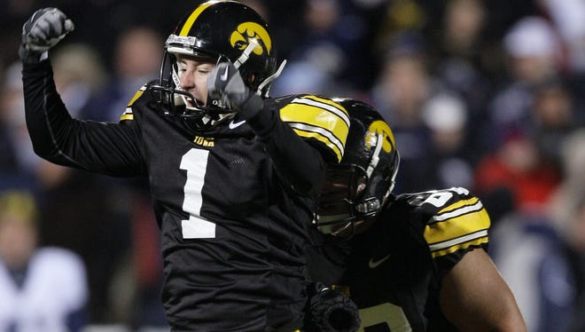 Iowa's Daniel Murray (1) celebrates after kicking the game-winning  31-yard field goal in the closing seconds of the fourth quarter of an NCAA college football game against Penn State, Saturday, Nov. 8, 2008, in Iowa City, Iowa.  Iowa won 24-23.  (AP Photo/Charlie Neibergall)
