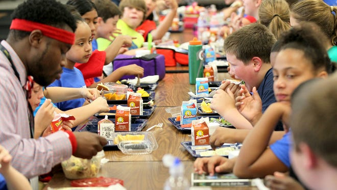 Pendleton Elementary School students eat on a past Fitness Day in the school cafeteria.