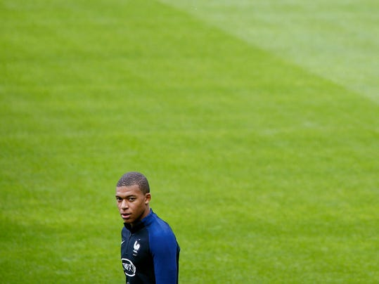 France's Kylian Mbappe attends a training session at the Stade de France stadium in Saint Denis, north of Paris, France, Monday, Oct. 9, 2017. France will play against Belarus during their World Cup Group A qualifying soccer match on Tuesday, Oct. 10. (AP Photo/ Thibault Camus )