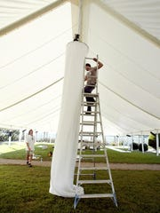Wayne Evans, left, and Matthew Heartfield setup up decorations Sept. 22, 2005 in one of two tents at the Historic Carnton Mansion for the upcoming Heritage Ball.
