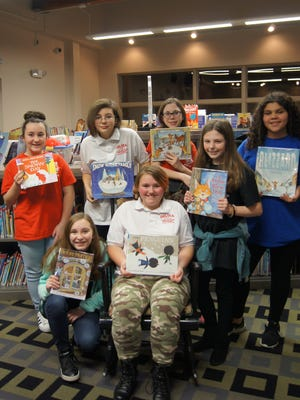 "There's ""snow"" better place to be on a blustery winter evening than Franklin Township Library! Members of Delsea Regional Middle School's Storytellers Club and community preschoolers stayed nice and toasty as they shared a flurry of stories and crafted a mug of hot chocolate and marshmallows during an evening story time.  Club members who participated: (front row, from left) Madison Beulah, Cheyenne Taylor, Cassidy Driscoll; and (back row, from left) Alicia Green, Grace Sink, Jacqueline Puglia, and Sarah Vidovic."