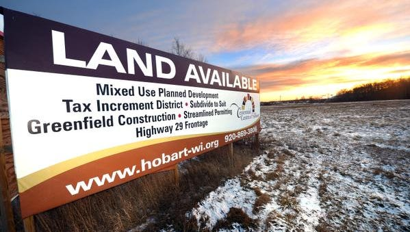 A billboard advertises the planned Centennial Centre development in Hobart along the south side of Wisconsin 29.