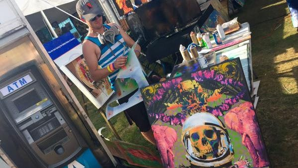 Tom McCabe of Electrified Designs spray painted this piece Sunday, July 26, 2015  Mo Pop Festival in Detroit.