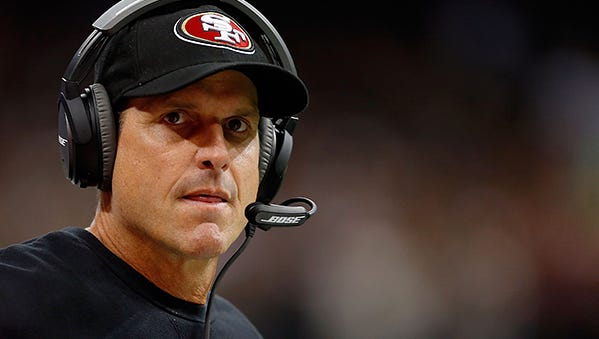 """I would want my son to play for him,"" John Kolesar said of Jim Harbaugh. They were Michigan teammates, Harbaugh a quarterback and Kolesar a receiver."