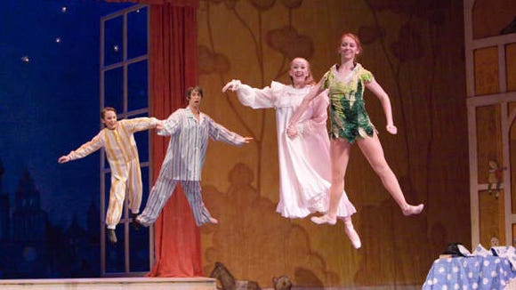 From left:  Michael Darling (Danny Steiner) John Darling (Eric White)  Wendy  Darling (Elizabeth Beckham) and Peter Pan (Brigitte Steinken) in Ballet Etudes presentation of Peter Pan at Mesa Arts Center from Friday to Sunday May 16-18. photo credit James Walls.