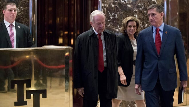 """Robert Carl """"Bud"""" McFarlane, second from left, is escorted by Michael Flynn, President-elect Donald Trump's nominee for National Security adviser, right, and K.T. McFarland, Deputy National Security Adviser for President-elect Donald Trump, second from right, as he departs Trump Tower, Monday, Dec. 5, 2016, in New York."""