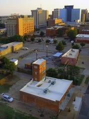 An aerial view with the Littlest Skyscraper in the foreground looks West at downtown Wichita Falls in the late afternoon light. The final round of voting for Wichita Falls to be featured on television show The Daytripper began Monday and will end Feb. 14.