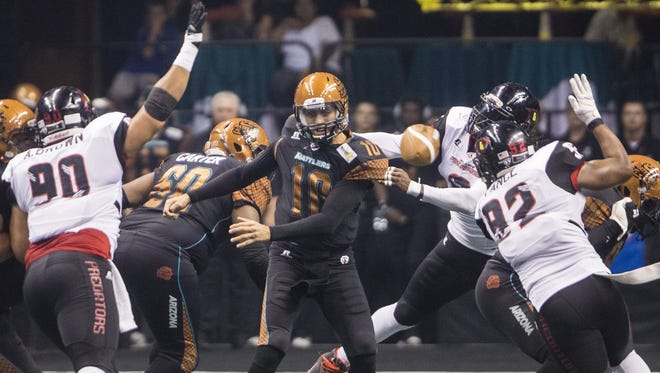 Predators' Terence Moore knocks the ball out of Rattlers' Nick Davila's hands on a pass at US Airways Center in Phoenix, AZ on June 20, 2015.