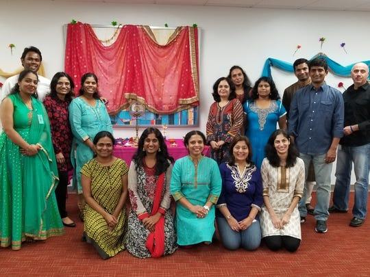 Employees at PCMS celebrate Diwali.