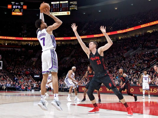 Sacramento Kings forward Skal Labissiere, left, shoots over Portland Trail Blazers center Zach Collins during the first half of an NBA basketball game in Portland, Ore., Tuesday, Feb. 27, 2018. (AP Photo/Craig Mitchelldyer)