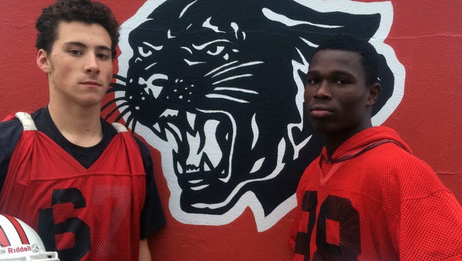 Senior quarterback Max Smyth, left, and receiver Kelvin Harmon, right, have hooked up for 14 touchdowns this season. The upperclassmen hope to bring Palmyra a title in Saturday's Central Jersey Group 1 championship.