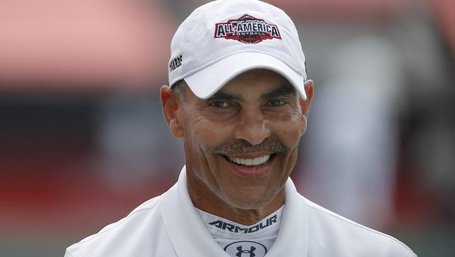 Team Highlight's  head coach Herm Edwards on the field in the Under Armour All American Football Game at the Orlando Citrus Bowl. Team Highlight beat Team Armour 27-0.