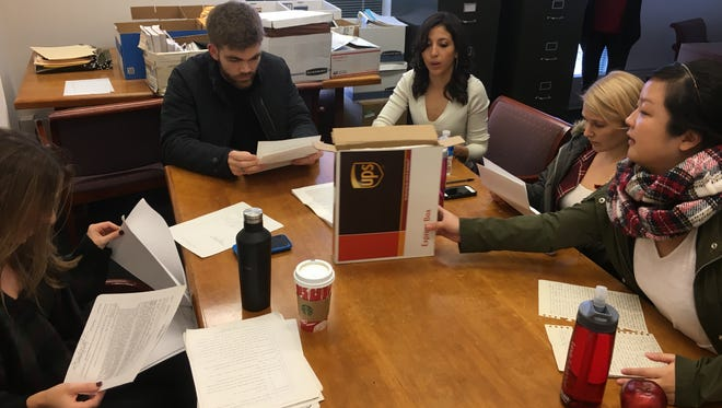 Students at the pro bono clinic work on a case for the Innocence Project on Dec. 5, 2016.