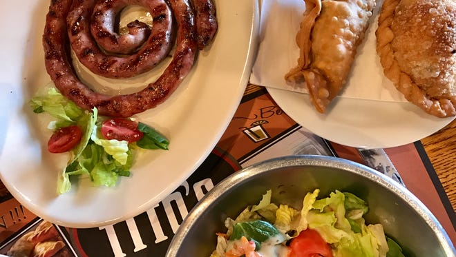 Salchichas, empanadas and a salad from Che Tito's Steakhouse in North Fort Myers.