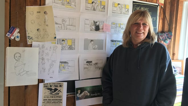 Illustrator Valerie Bouthyette of Pine City shows off sketches for an animated Civil War film she is helping to create.