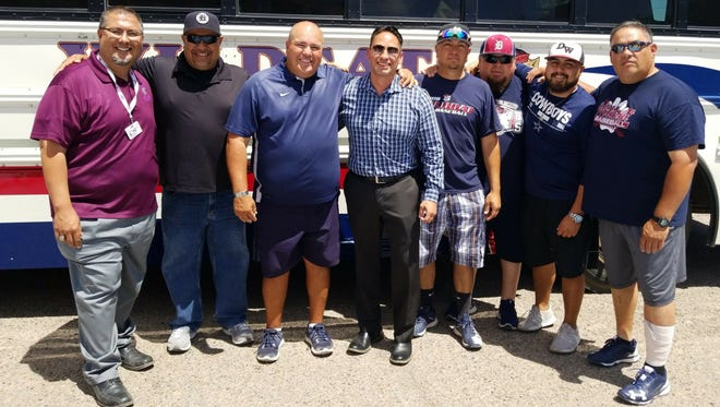 New Mexico Sen. Howie Morales (striped shirt) visited with Deming High coaches and players who were state-bound last Wednesday while on the campaign trail for Lt. Governor of New Mexico.