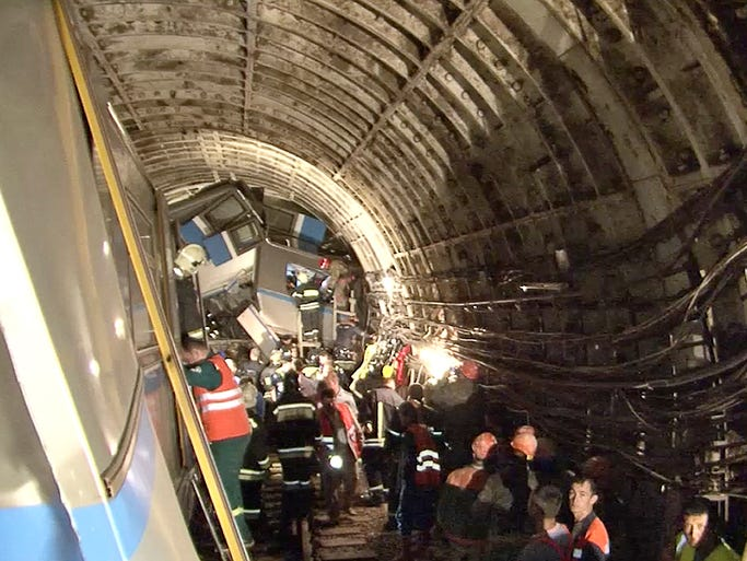Rescuers work at the scene of a subway train derailment between Park Pobedy and Slavyansky Bulvar stations on July 15 in Moscow.