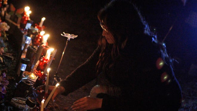 Friends and family attend a candlelight vigil for Shadow McClaine on Tuesday, marking one year since the Fort Campbell soldier's body was discovered near Maxey Road.