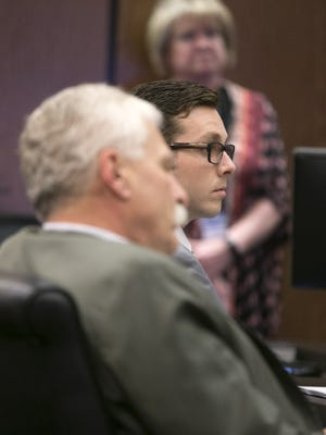 """Former Mesa police Officer Philip """"Mitch"""" Brailsford (right) and his attorney, Mike Piccarreta, listen as Judge George Foster gives jury instructions at the start of Brailsford's second-degree murder trial at Maricopa County Superior Court in Phoenix on Oct. 25, 2017."""