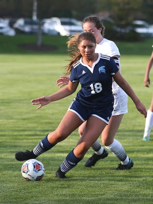 Controlling the ball Tuesday night is Livonia Stevenson's Kennedy Thurlow (18).
