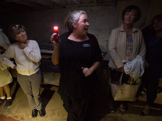 Melissa Hartman tells stories of hauntings and Fort Collins history underneath the streets of Old Town Saturday, October 15, 2016. Fort Collins Tours leads people underground for a different look at the city.