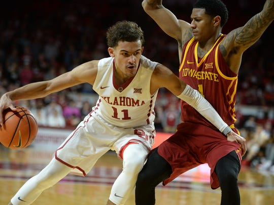 Oklahoma Sooners guard Trae Young (11) dribbles the